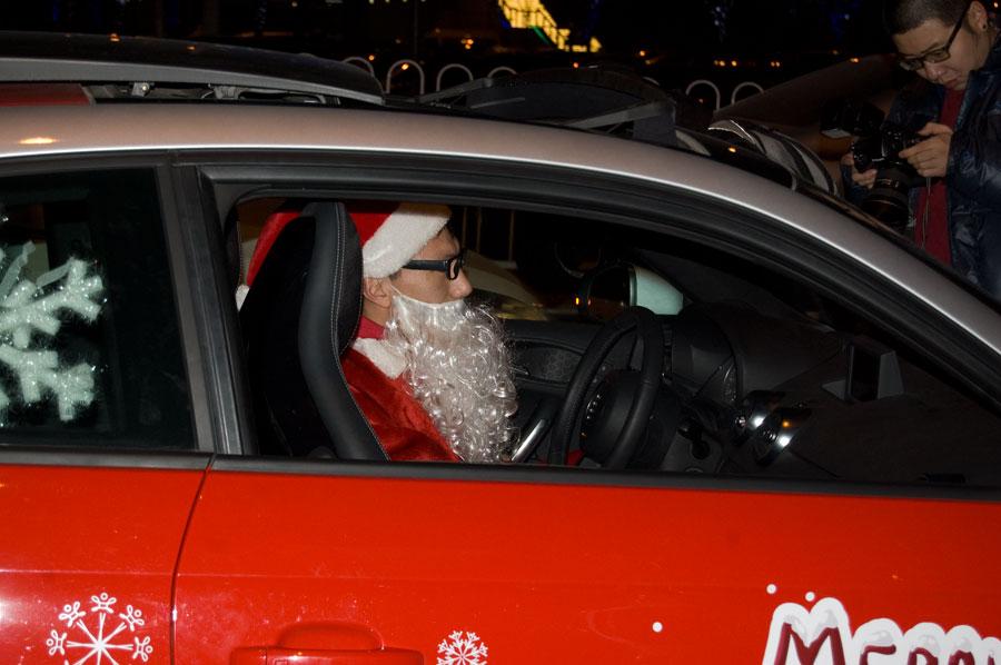 Chinese santa in red Audi